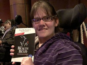 "Amanda holds up her program for ""Beauty and the Beast"""